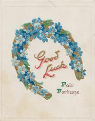 GOOD LUCK in red  below blue forget-me-nots on gilt horseshoe, FAIR FORTUNE below