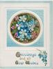 GREETINGS AND ALL GOOD WISHES(G,G,&W illuminated) in gilt below blue & purple forget-me-nots in gilt & blue squared circular design