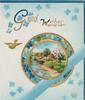 GOOD WISHES in gilt, forget-me-nots around circular gilt & forget-me-not bordered rural inset, gilt bird flies, printed blue ribbon