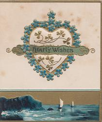 HEARTY WISHES on green band across forget-me-not bordered heart, seascape inset at base