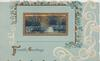 FRIENDLY GREETINGS in gilt, forget-me-not & white design right & above gilt framed watery rural inset, blue background