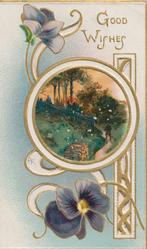 GOOD WISHES in gilt purple pansies above & below circular rural inset, perforated gilt design