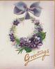 GREETINGS in gilt, wreath of violets & moss hanging from purple ribbon