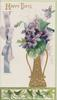 HAPPY DAYS in gilt, violets in tall gilt vase, printed pale purple ribbon & bow over perforated ivy leaf design below