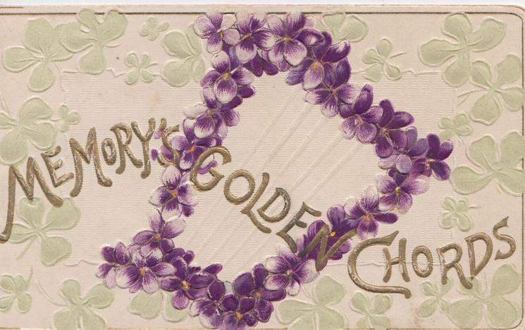 MEMORIES GOLDEN CHORDS in gilt, violets in central design, pale green stylised leaves as background