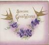 SINCERE GOOD WISHES in gilt above chain of violets sujpported by gilt birds violets right