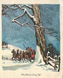 CHRISTMAS LONG AGO stagecoach drives forward left of prominent tree, night blue sky with snow falling