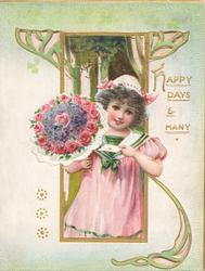 HAPPY DAYS AND MANY in gilt, girl in pink stands left holding letters & many roses in front of perforated gilt & green design
