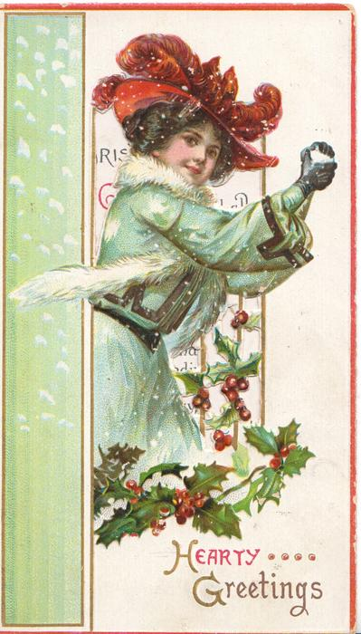 HEARTY GREETINGS, woman in blue coat & red hat holds snowball, above perforated holly, green panel left