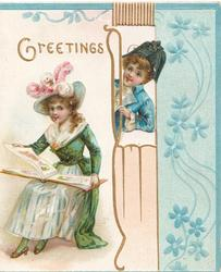 GREETING in gilt, girl sits left reading picture book, boy peeks through perforated design, stylised forget-me-nots right
