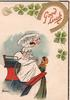 GOOD LUCK in red under horseshoe & shamrock, lady in white sits high extending hand to girl in green