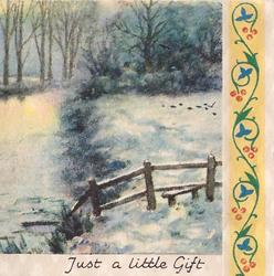 JUST A LITTLE GIFT creek & field in winter, small wooden fence, trees in background, stylised floral panel right