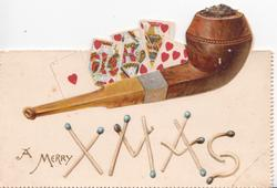 A MERRY XMAS with xmas spelt using matches, pipe & playing cards