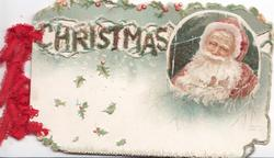 CHRISTMAS glittered & perforated left inset of Santa, head & shoulders right, sparse holly & leaves