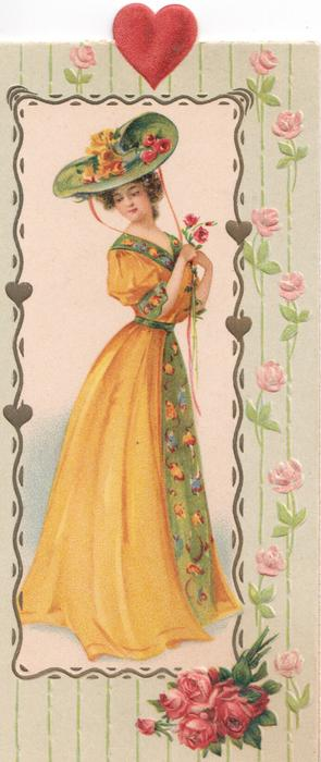 no front title, pretty girl in orange holds flowers, facing right looking back over her shoulder, roses below, heart above