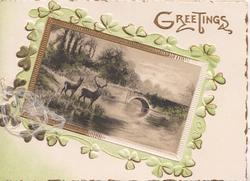 GREETINGS in gilt, gilt bordered rural inset with 2 stags surrounded by clover leaves