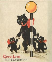 GOOD LUCK AND BE(A)CON/TENT black cat holds hands with two kittens & crosses road, each wear bows