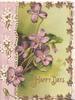 HAPPY DAYS In gilt below violets, designed floral margins