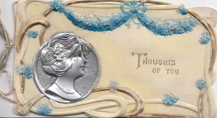 THOUGHTS OF YOU in gilt, silver medallion of girls head heavily embossed, forget-me-not  design, cream background