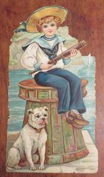 sailor boy sitting on bollard, white dog sitting at base