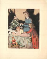 no front title, mother & children look at baby in bassinet, girl holds candle, Xmas tree behind, Santa & holly front