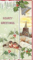 HEARTY GREETINGS in red left, bell above snowy rural church inset, 3 bullfinches perch on berried holly below