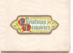 CHRISTMAS MEMORIES within perforated window, gilt border & filigree background, illuminated  'C' & 'M', holly