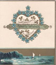 HEARTY WISHES across forget-me-not & gilt bordered heart shaped plaque above sea-scape inset at base