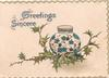 GREETINGS SINCERE(G & S illuminated) above blue & white pot behind berried  holly