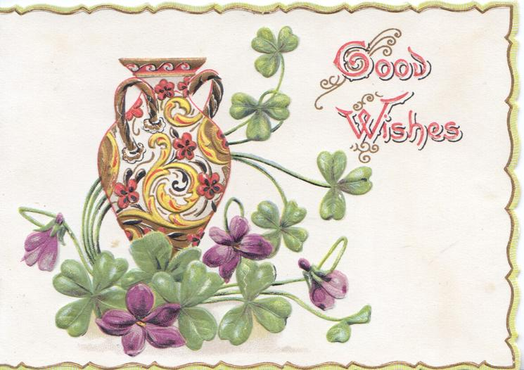 GOOD WISHES(illuminated) in pink, above right, violets below & round tall ornamental vase, 3 narrow green margins