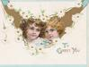 TO GREET YOU.(T,G, & Y illuminated) below chain of white daisies surround gilt inset head & shoulders of 2 pretty girls, top corners have small blue designs
