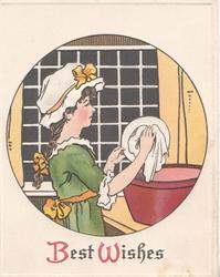 BEST WISHES (B &W illuminated) woman in green dress & white cook's hat washes dish, black window behind