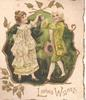 LOVING WISHES in gilt, man & woman in old style dress dance in front of dark green inset, gilt surrounding & marginal design