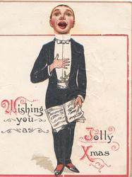 WISHING YOU A JOLLY XMAS(W,J & X illuminated), singer in evening dress stands facing front