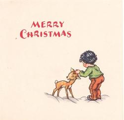 MERRY CHRISTMAS in red above young boy facing away patting fawn