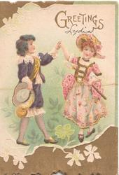 GREETINGS in gilt, boy & girl in old style dress hold hands & dance, set in deep brown inset