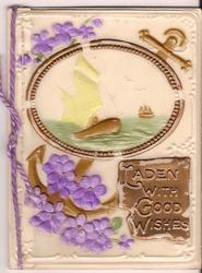 on celluloid front LADEN WITH GOOD WISHES on gilt plaque, inset of boat surrounded by purple flowers