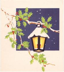 no front title, snow covered lantern hangs from holly branch over dark blue square, white background behind