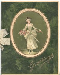 GREETINGS in gilt below oval inset of woman in old style dress carrying basket of flowers, dark green background
