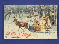 old time Santa in sleigh pulled by reindeer in forest