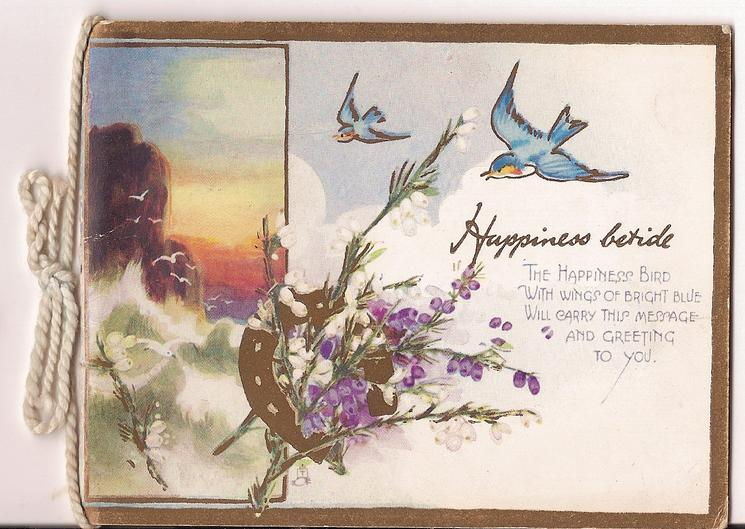 HAPPINESS BETIDE horseshoe with flowers and two bluebirds in flight beside ocean inset