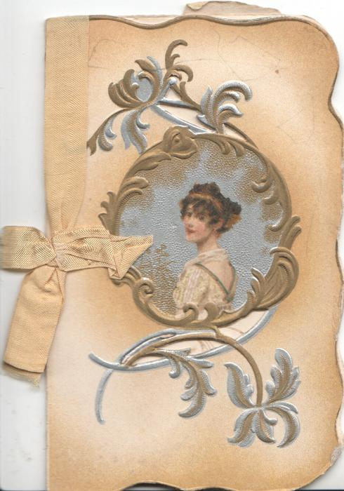 no front title, inset head &  shoulders of pretty girl, surrounded by gilt & silver design, cream stock