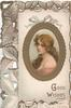 GOOD WISHES in gilt below gilt bordered inset oval pretty girl, perforated white/brown blackberry design