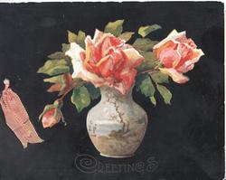 GREETINGS in gilt below cracked vase of pink roses, black background
