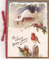 FOR A CHEERY HAPPY SEASON robin perched on pole looks towards snowy cabin
