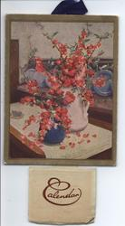two jugs with red flowers on table, blue dish set on display behind