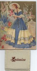lady in fancy blue and white dress holds bouquet of flowers
