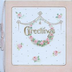 GREETINGS in gilt below swastica on gilt chain, pink roses around, pale brown borders
