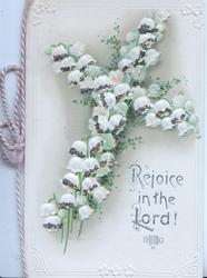 REJOICE IN THE LORD! in silver below glittered cross made of lilies-of-the-valley