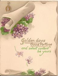 GOLDEN DAYS GOOD FORTUNE AND SWEET CONTENT BE YOURS scroll on top of pile of violets